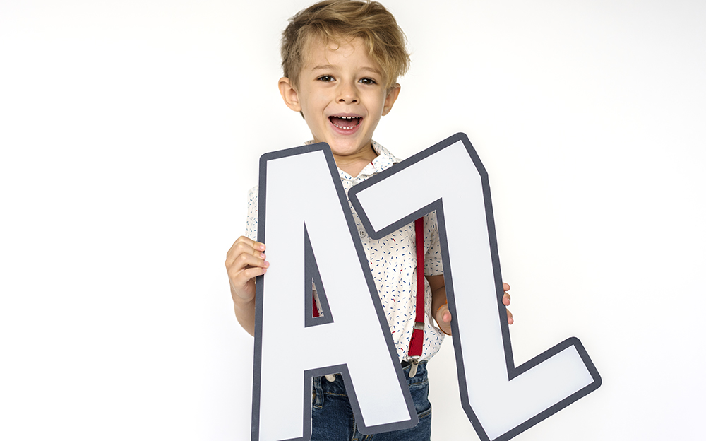 Little boy holding A-Z