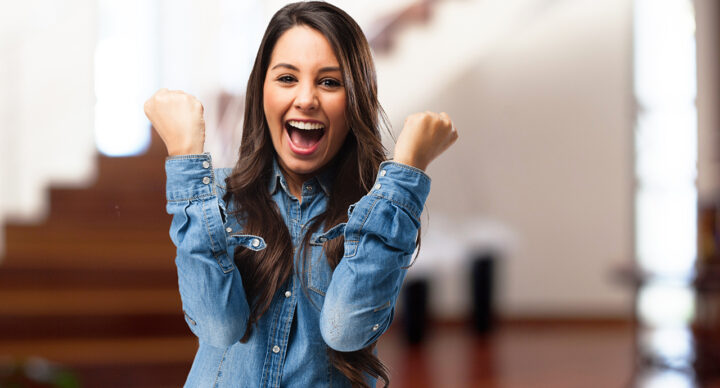 happy young woman victory sign